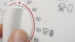 Programming washing machine. Choosing the temperature. Sixty degrees Celsius Stock Footage