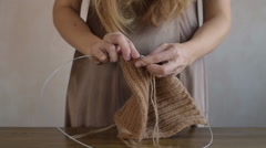 Woman in a bedgown knitting Stock Footage