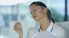 4K Electronics engineer examining microchip under magnifier Stock Footage