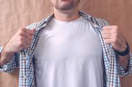 Man revealing white t-shirt as copy space Stock Photos