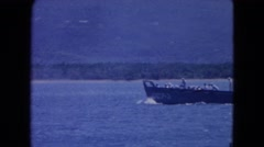 1964: a beach scene is seen with a boat SAN JUAN, PUERTO RICO Stock Footage