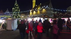 Tallin, Christmas/New year time fair Town hall square illuminated pov steadicam. Stock Footage