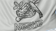 Close up of waving flag with Nestle logo, seamless loop, blue background Stock Footage