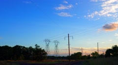 Electricity pylon beautiful late evening sunset Stock Footage