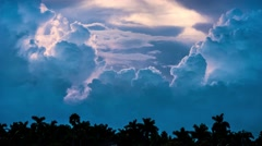 Epic storm tropical clouds over palm trees silhouettes at sunset 4K UHDTimelapse Stock Footage