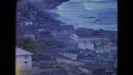 1964: various homes built on the side of a mountain overlooking the ocean Stock Footage