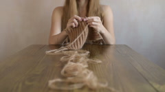 Woman knitting a scarf Stock Footage