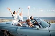 Group of happy young people driving a car Stock Photos