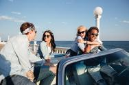 Multiethnic group of people talking and having fun in cabriolet Stock Photos