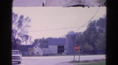 1968: traffic at dead end intersection at stop sign in front of a barn WAUCONDA Stock Footage