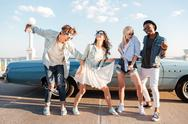 Cheerful young friends dancing together outdoors Stock Photos