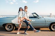 Cheerful young couple dancing outdoors and having fun Stock Photos