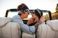 Couple kissing in cabriolet in summer Stock Photos