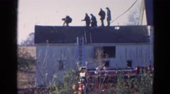 1968: vintage clip of firemen on the roof of the house Stock Footage