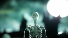 Crazy skeleton funny dancing on the cemetery . Halloween concept. Stock Footage