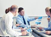 Business people with papers meeting in office Stock Photos