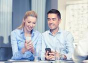 Smiling business people with smartphones in office Stock Photos