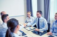 Group of smiling business people meeting in office Stock Photos