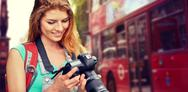 Woman with backpack and camera over london city Stock Photos