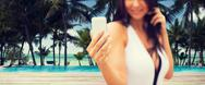 Young woman taking selfie with smartphone on beach Stock Photos