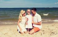 Happy family in sunglasses on summer beach Stock Photos