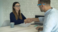 Client signing legal documents in office with businesswoman  Stock Footage