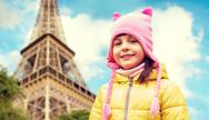 Happy little girl over eiffel tower in paris Stock Photos