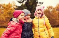 Group of happy children hugging in autumn park Stock Photos