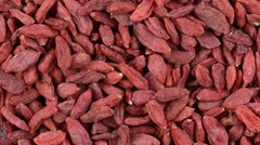 Dried Goji Berries. Rotates plate with bright berries Goji. Close up Stock Footage