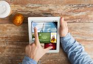 Close up of hands with news page on tablet pc Stock Photos