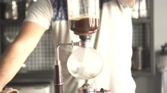 Making syphon coffee, syphon coffee is a new way to brew third generation coffee Stock Footage