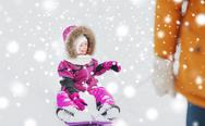 Happy little kid on sled outdoors in winter Stock Photos