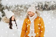 Happy couple walking over winter background Stock Photos