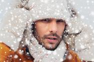 Face of man in winter clothes outdoors Stock Photos