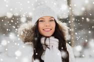 Happy woman outdoors in winter clothes Stock Photos
