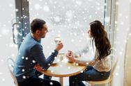 Happy couple drinking tea and coffee at cafe Stock Photos