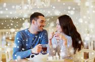 Happy couple drinking tea at cafe Stock Photos
