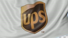 Close up of waving flag with United Parcel Service UPS logo, seamless loop, blue Stock Footage