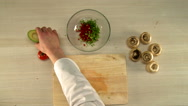 Cooking food. Top view of chef cuts avocado Stock Footage