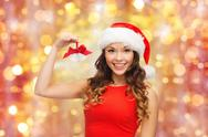 Woman in santa helper hat with jingle bells Stock Photos