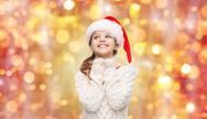 Dreaming girl in santa helper hat Stock Photos
