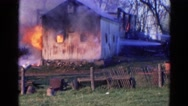 1968: a house is seen destroyed with fire WAUCONDA, ILLINOIS Stock Footage