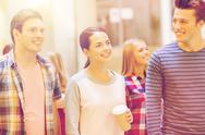 Group of smiling students with paper coffee cups Stock Photos