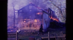 1968: wooden cabin under heavy fire among the dried trees WAUCONDA, ILLINOIS Stock Footage