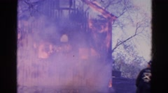 1968: huge fire completely destroys home while firefighters monitor  Stock Footage