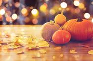 Close up of halloween pumpkins on wooden table Stock Photos
