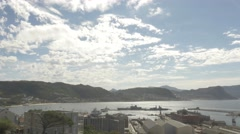 4k Time Lapse Mountains Naval Dock Pier Ocean Beach Sunny Clouds Stock Footage