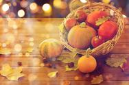 Close up of pumpkins in basket on wooden table Stock Photos