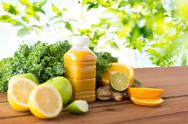 Bottle with orange juice, fruits and vegetables Stock Photos