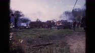 1968: fire trucks pulling up the scene assessing the damage of the blaze Stock Footage